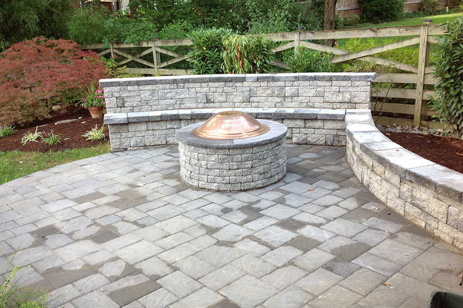 Firepit on beautiful patio and retaining wall