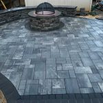 Blue and grey stone patio with firepit