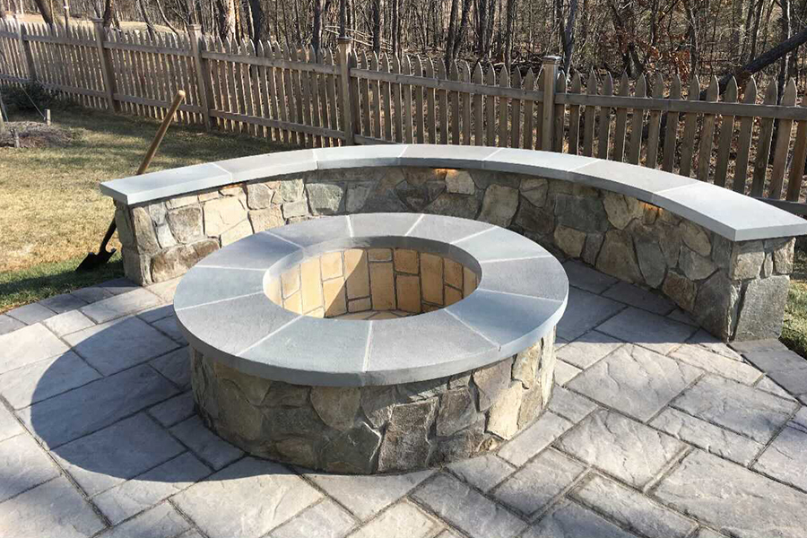 Patio with built in firepit and sitting wall