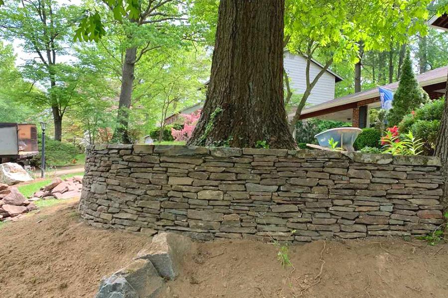 Flagstone garden bed wall around tree