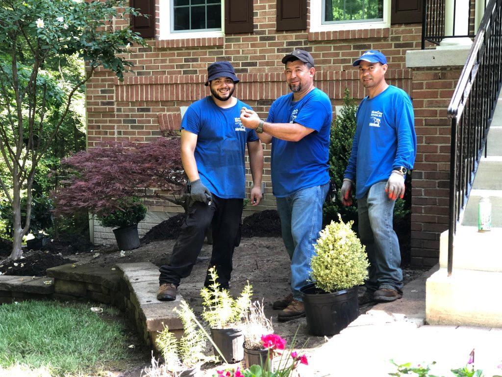 Happy landscape plant installation crew