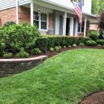 Retaining wall with mulch and plants