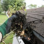Gutter cleaning with hand