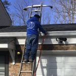 Washing out gutters after cleaning