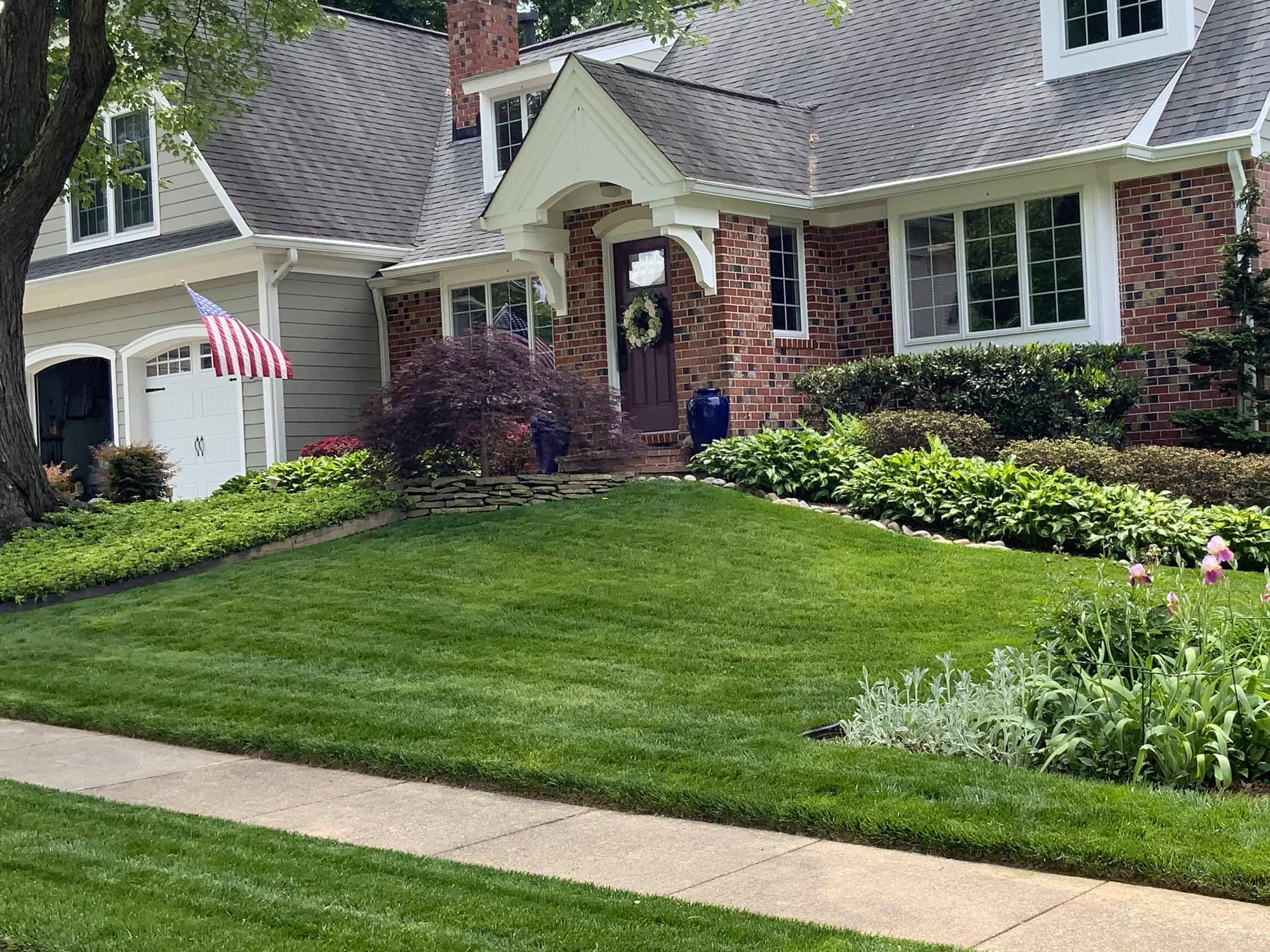 Mowing lawn of suburban home