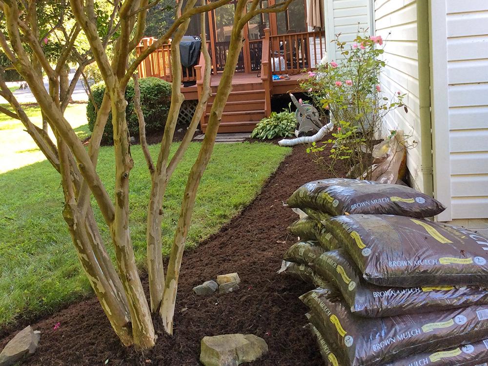 Rent-a-crew installing landscape mulch materials